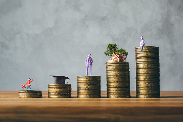 BVS Blog Image - Figures standing on coin stacks